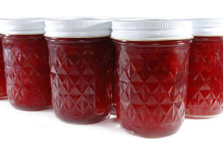 Multiple jars of homemade fruit jam. photo