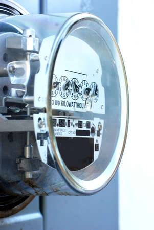 Electric meter, closeup, on outside wall photo
