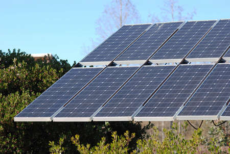 Large solar panels outside with blue sky. photo