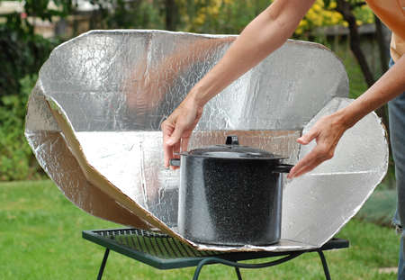 concave: Solar Cooking Oven with black pot.