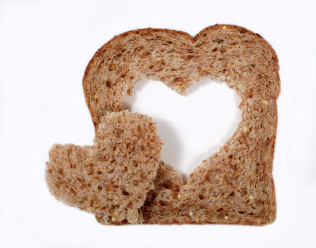 A slice of whole wheat bread with a heart shape. photo