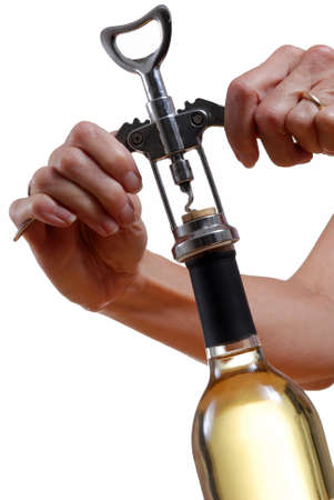 sauvignon blanc: Closeup of hands opening a wine bottle with corkscrew  Stock Photo