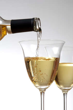 Pouring white wine into wine goblets Stok Fotoğraf