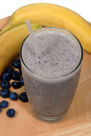 soymilk: Banana, blueberry fruit smoothie in a glass near fresh, organic fruit