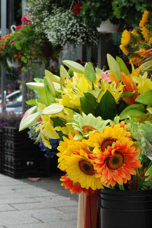 merchant: Outdoor, sidewalk flower stand.