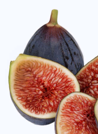 Fresh, organic figs isolated on white.  Whole and sliced figs together.