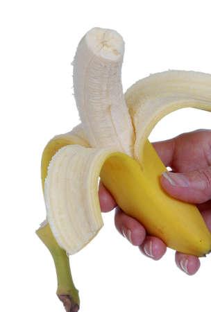 Hand holding a fresh, organic banana.  Isolated on white