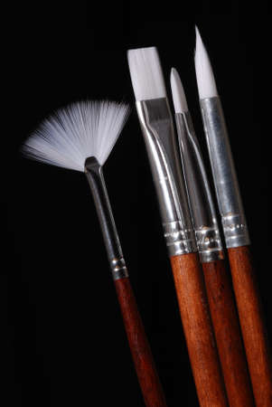 A set of artist's paint brushes, isolated on black. Stock Photo