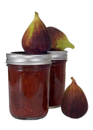 Homemade, organic fig jam with fresh figs.  Isolated on white. Imagens