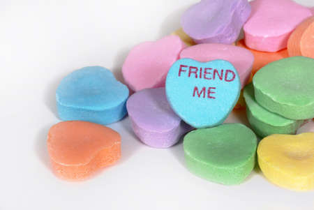 Valentine candy hearts with the words FRIEND ME Stock Photo