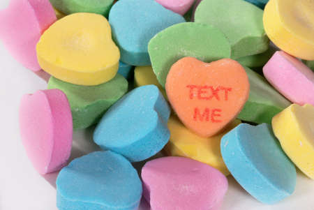 Valentine candy hearts with the words TEXT ME