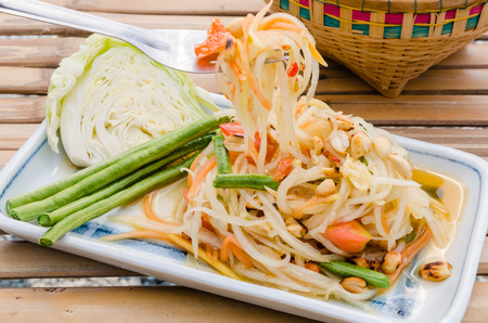green papaya salad: Closeup spicy green papaya salad. Traditional Lao and Thai dish.
