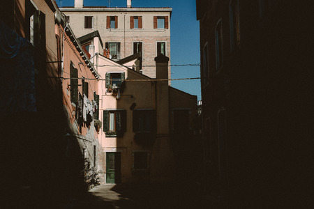 photgraphy: The sun is creating a light and shadow scene on houses in Venice, Italy