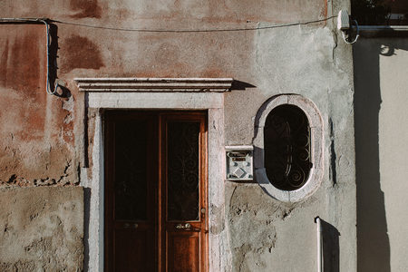 photgraphy: The facade of a house with the entrance door in Venice, Italy.
