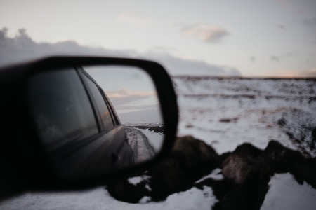 Looking onto an Icelandic landscape through the back of a car.