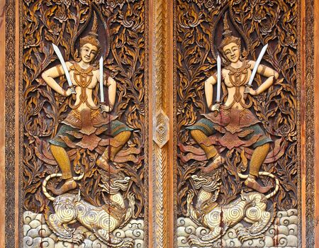 Carving Wood at Door of Temple Stock Photo