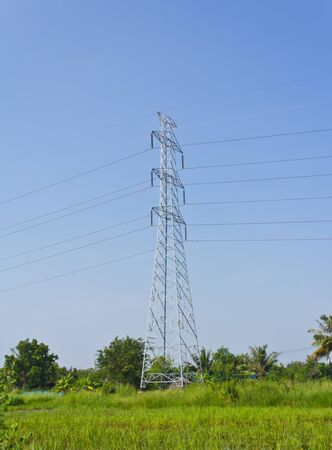 Electric tower on green field