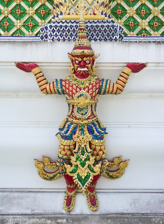 Red giant statue in thailand temple
