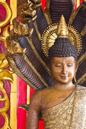 Wooden buddha statue in thailand temple