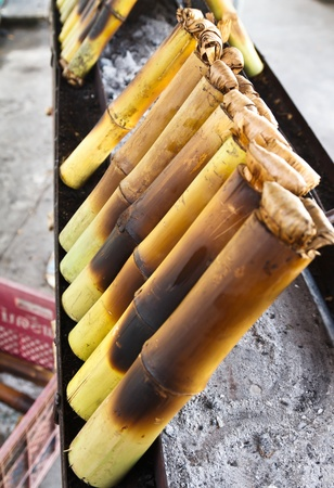 Glutinous rice roasted in bamboo joints  Thai food  Stock Photo