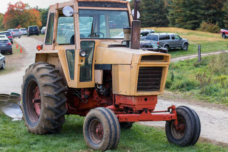 Tractor parked in a field. Stock Photo