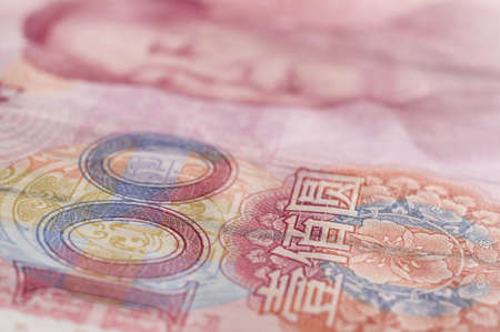 Macro-shot for Renminbi  RMB  , 100 hundred dollar  Mao s eyes gaze at the number  100   Banco de Imagens