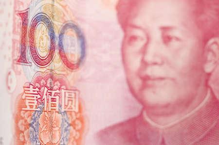 macroshot: Macro-shot for Renminbi  RMB  , 100 hundred dollar  Mao s eyes gaze at the number  100   Stock Photo