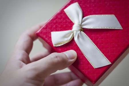 human's arm: Man hands holding gift box Stock Photo