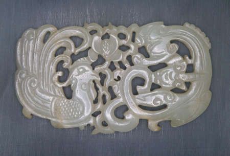 19th: 19th century jade carved dragon and phoenix.