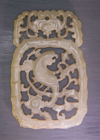 auspiciousness: 19th century jade carved a traditional pattern:. Magpie on a plum blossom tree Magpie is symbol of auspiciousness in chinese traditional cultures. Stock Photo