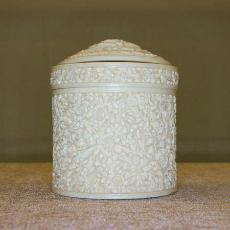 19th: 19th century ivory rouge box, carved with Oriental flowers.