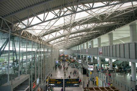 Guangzhou, China - Oct 24, 2014: Large group of passengers inside Baiyun Airport