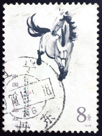 chinese postage stamp: CHINA - CIRCA 1978: A stamp printed running horse, circa 1978. This traditional Chinese painting was painting by outstanding paintings masters Xu Beihong.