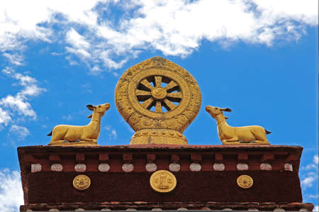 dharma: Golden Dharma Wheel at the Potala Palace in Lhasa, Tibet.
