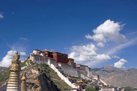 the Potala Palace in Lhasa. Golden chorten (or stupa) at left. Tibet.