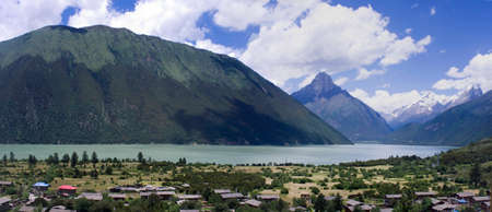 jokul: Basum Lake is a barrier lake, and is ringed by mountains. By the lake there is a village. Serene beauty and quiet. Basum Lake lies GongBu jomda, tibet, china.