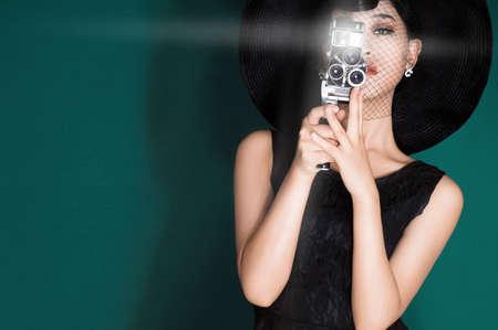 glossiness: Fine art portrait of a beautiful lady taking a photograph