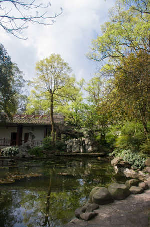 chinese courtyard: Ancient chinese courtyard and pond Stock Photo