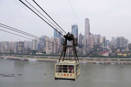 sightsee: Chongqing, China - April 21, 2013: Cable Car on Yangzi river. Passengers travel by cable car from side to other side of the river.