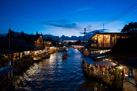 amphawa: Bangkok, Thailand - September 26, 2015: Unidentified People and Tourist at Amphawa Floating Market at night.
