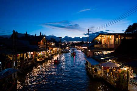 amphawa: Bangkok, Thailand - September 26, 2015: Unidentified People and Tourist at Amphawa Floating Market at night.