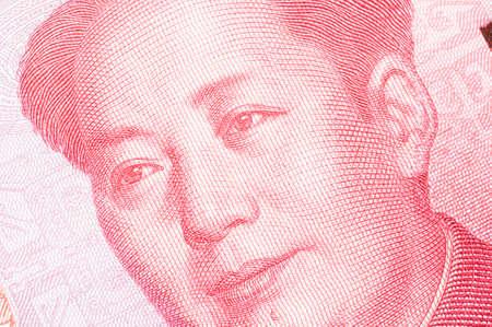 macroshot: Macro-shot for Renminbi RMB , gloden 100 hundred dollar. Maos eyes gaze at the number 100. Stock Photo