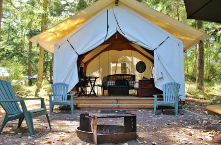 fire pit: Luxurious glamping cabin in the woods with fire pit Editorial