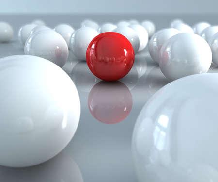 Een rode stip in vele witte ballen  Stockfoto