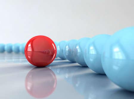 Un bal rosso di fronte molti blu