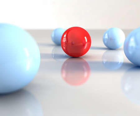 volunteer point: A red ball with other blue around Stock Photo