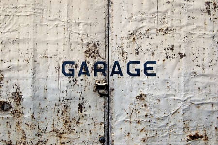 A rusted old door of a garage Stock Photo - 7035494
