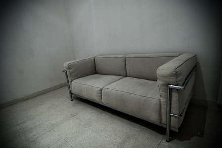 A grey sofa in a grey room photo