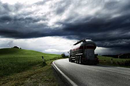 A white truck run on a road Stock Photo - 7035499