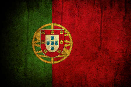 An old grunge flag of Portugal state Stock Photo - 7654696